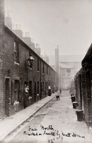 Slum dwellings looking west from upper Bedford Street to All Souls School showing the back walls, and the dustbins of Essex Street.  Brighton in 1914 was a town of extreme poverty and wealth.  Photo reproduced courtesy of James Gray Collection /The Regency Society.