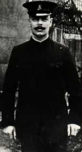 Workhouse officer in uniform in the grounds of Elm Grove workhouse. PHOTOGRAPH by (unknown